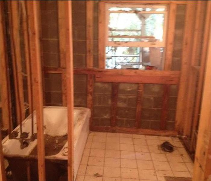 Bathroom with studs exposed